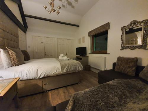 A bed or beds in a room at Thorpe Thewles Lodge