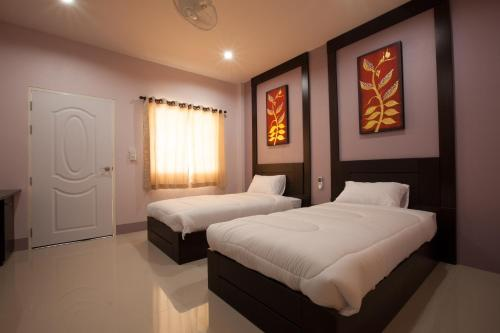 A bed or beds in a room at Chiangkham Grand Villa