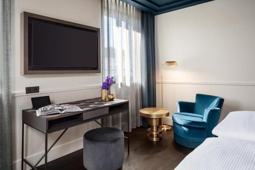 TV/Unterhaltungsangebot in der Unterkunft Hotel AMO by AMANO Friedrichstraße