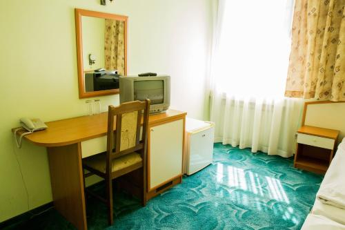 A television and/or entertainment center at Struma Hotel
