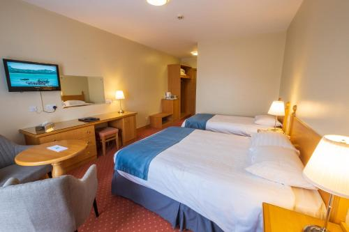 A bed or beds in a room at Cromore Halt