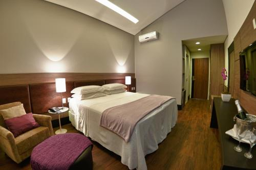 Cama ou camas em um quarto em Cordilheira Hotel