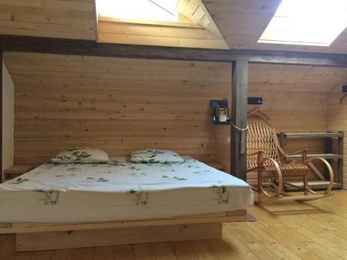 A bed or beds in a room at Art d'ECO