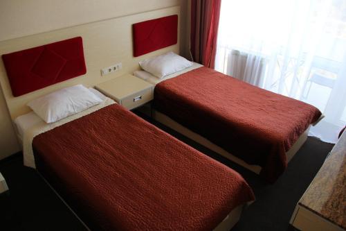 Кровать или кровати в номере Отель Волна