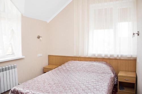 Кровать или кровати в номере Гостевой Дом Партия