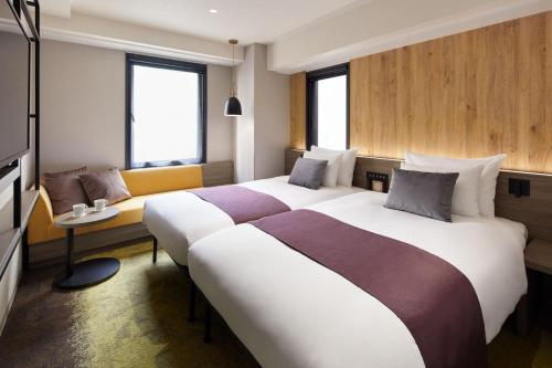 A bed or beds in a room at the b ochanomizu