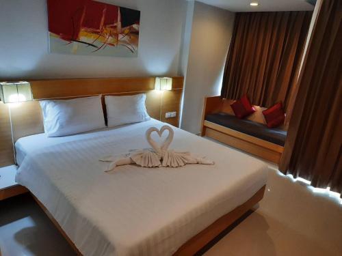 Кровать или кровати в номере Aspery Hotel