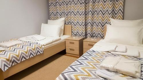 Кровать или кровати в номере мини-отель Arctic Hotel