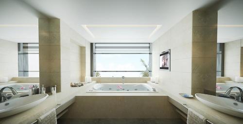 A bathroom at Triumph City Hotel & Residences