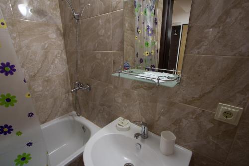 Ванная комната в Парк Отель Марат