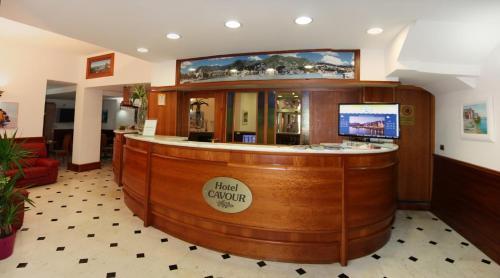 Лобби или стойка регистрации в Hotel Cavour
