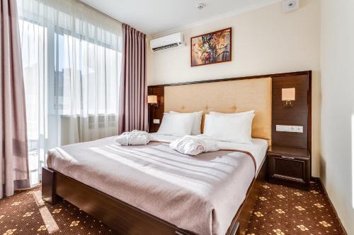 Ліжко або ліжка в номері Bratislava Hotel Kyiv