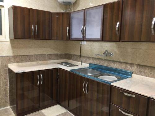 A cozinha ou cozinha compacta de Zahret Al-Badea Hotel Apartments