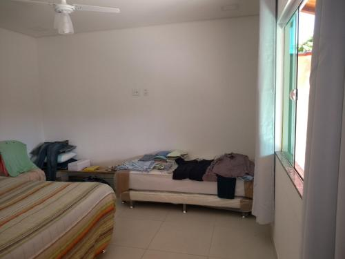 A bed or beds in a room at Casa pequena em Buzios-RJ