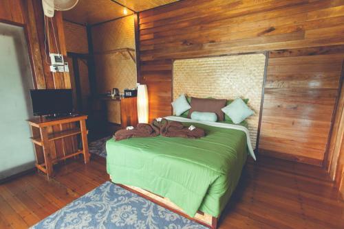 Ein Bett oder Betten in einem Zimmer der Unterkunft Bayview Hill Resort