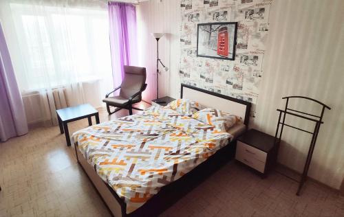 Кровать или кровати в номере Апартаменты на Ул. Гоголя, д. 103