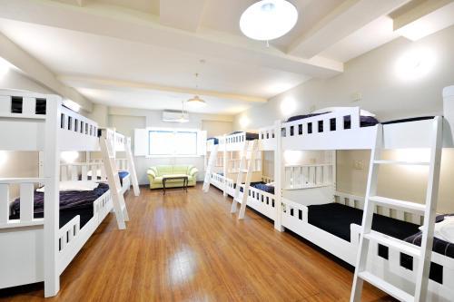 A bunk bed or bunk beds in a room at Khaosan World Asakusa Ryokan & Hostel