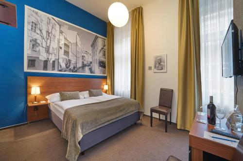 A bed or beds in a room at Metropolitan Old Town Hotel - Czech Leading Hotels