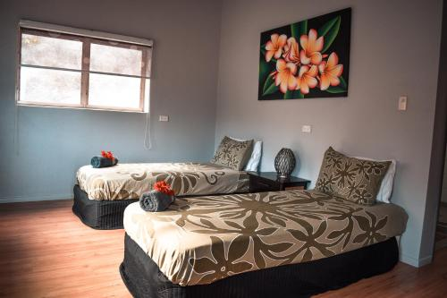 A bed or beds in a room at Iro Luxury Retreat