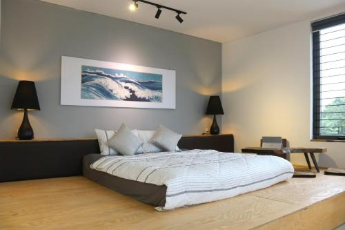 A bed or beds in a room at NANO ECO-HOSTEL