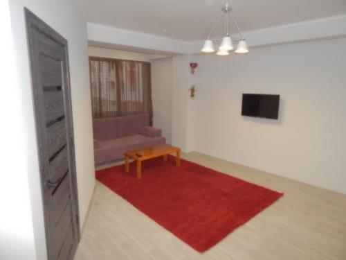 Televizorius ir (arba) pramogų centras apgyvendinimo įstaigoje Comfortable apartment for you