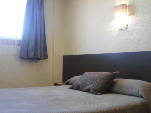 Llit o llits en una habitació de Hostal El Callejón
