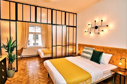 Letto o letti in una camera di CAMŌ Boutique Apartments