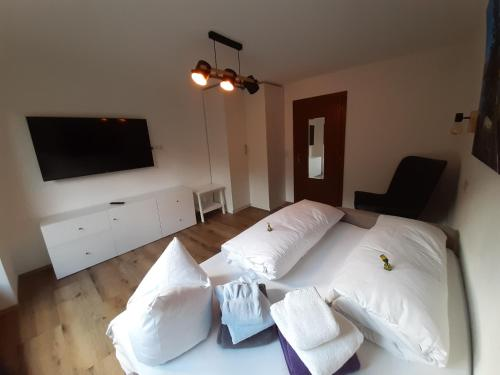 Ein Bett oder Betten in einem Zimmer der Unterkunft Apart Tuxertal