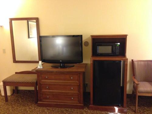 A television and/or entertainment center at Best Western El Grande Inn