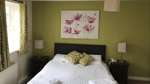 A bed or beds in a room at Park Head Hotel & Restaurant