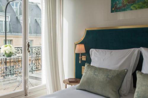 Cama ou camas em um quarto em Hôtel Alfred Sommier