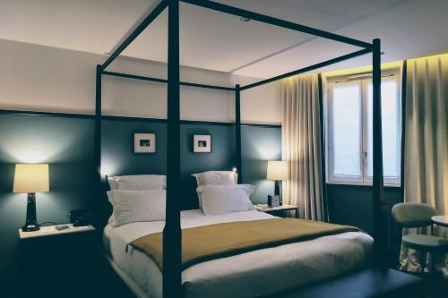 A bed or beds in a room at The Chess Hotel