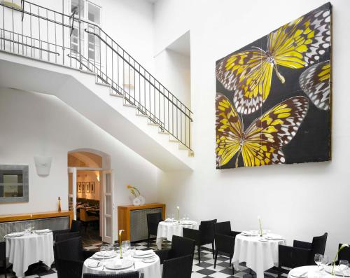 A restaurant or other place to eat at art'otel budapest, part of Radisson Hotel Group