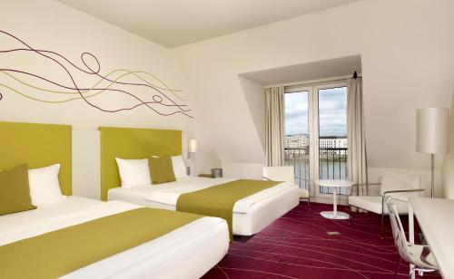 A bed or beds in a room at art'otel budapest, by park plaza