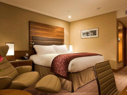 A bed or beds in a room at Sofitel London Heathrow