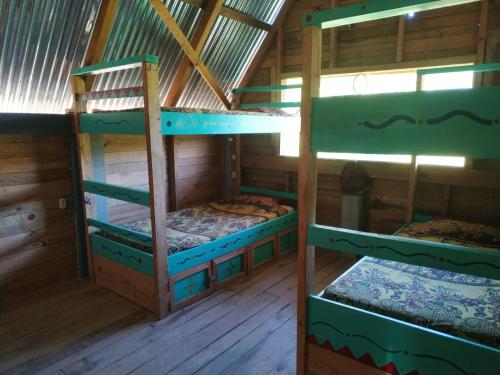 A bunk bed or bunk beds in a room at Ch'i Bocól Community Hostel