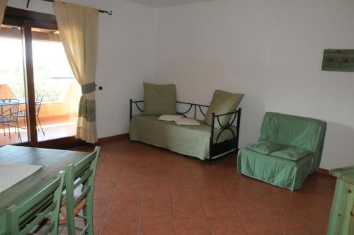 A seating area at Il Borgo Di Punta Marana
