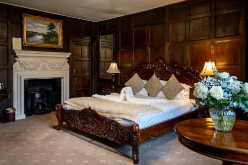 A bed or beds in a room at Castle Bromwich Hall; Sure Hotel Collection by Best Western