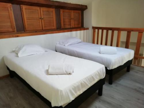 A bed or beds in a room at Boulevard de la Thèse Marseille