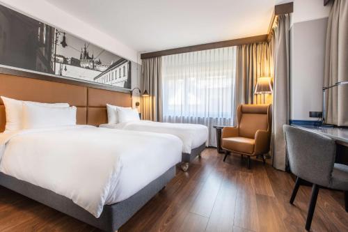 מיטה או מיטות בחדר ב-Radisson Blu Hotel Prague