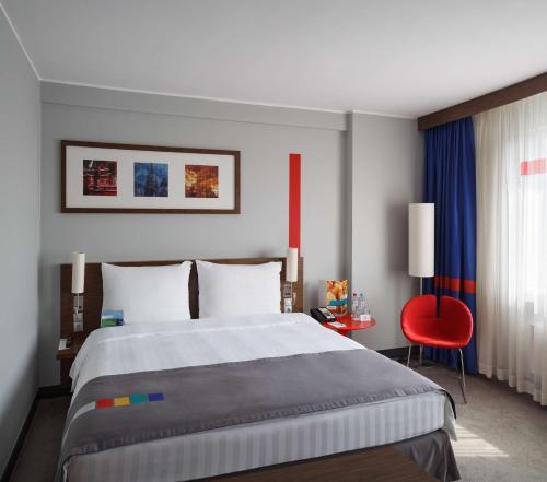 Кровать или кровати в номере Отель «Парк Инн от Рэдиссон Аэропорт Шереметьево Москва»