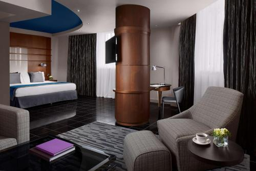 A bed or beds in a room at Radisson Blu Hotel, Leeds City Centre