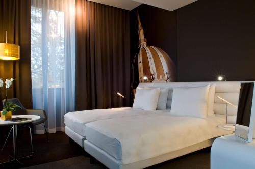 Кровать или кровати в номере Radisson BLU Hotel Nantes