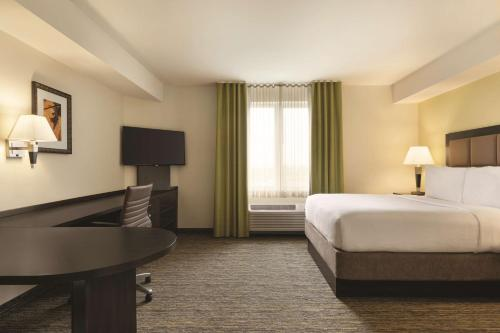 A television and/or entertainment center at Park Inn by Radisson, Calgary Airport North, AB