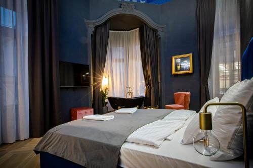 A bed or beds in a room at Noble Boutique Hotel - Adults Only