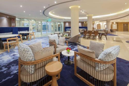 O lounge ou bar de Radisson Blu Resort, Al Khobar Half Moon Bay