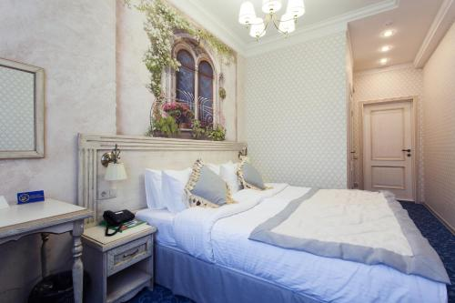 Кровать или кровати в номере Alex Residence