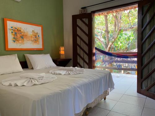 Cama ou camas em um quarto em Pousada Do Rio