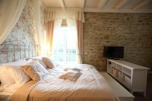 Кровать или кровати в номере Отель Imperial & Champagne SPA