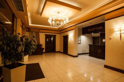 Лобі або стійка реєстрації в Maria Garden hotel & restaurant
